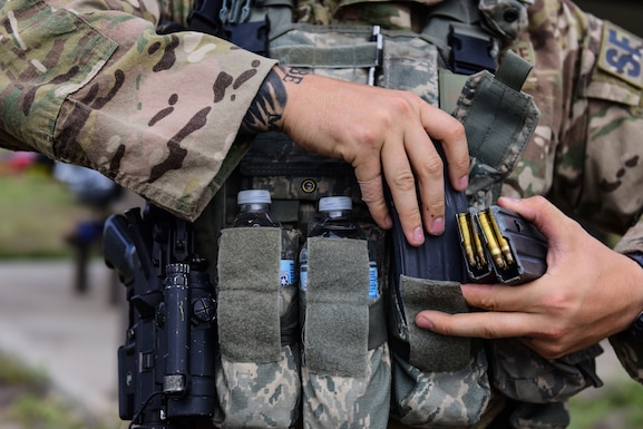 Staff Sgt. Codey Doehrmann, 47th Security Forces Squadron military working dog handler, preps his gear before heading out for an exercise at Laughlin Air Force base, Texas, April 17, 2019. During the defender's exercise, Doehrmann and the K-9 team lead the pack as they tracked down the simulated opposing force in the farthest reaches of Laughlin's perimeter. (U.S. Air Force photo by Senior Airman Benjamin N. Valmoja)