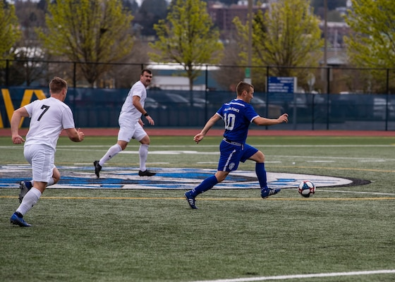 NAVAL STATION EVERETT, Wash. (April 18, 2019) -- Air Force Capt. Johnny Melcher travels the mid-field looking for a goal during the 2019 Armed Forces Men's Soccer Championship.  (U.S. Navy Photo, MC2 Ian Carver/Released)