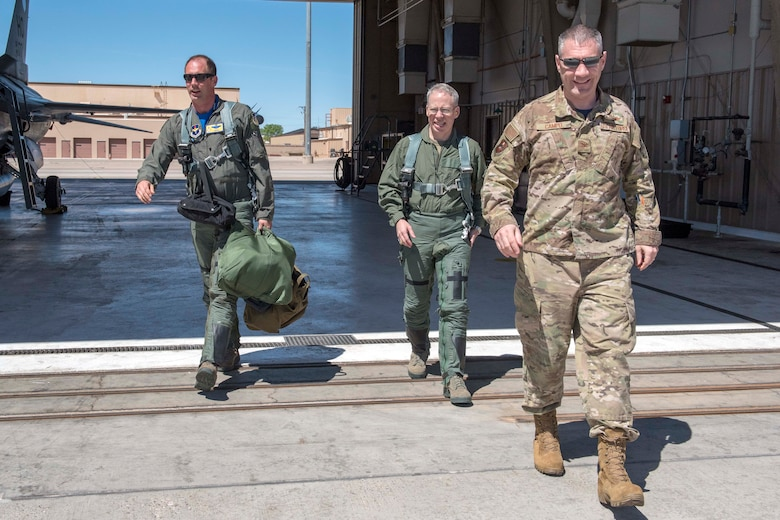 U.S. Air Force Col. Joseph Campo, 49th Wing commander (right), and Lt. Col. Peter Kasarskis, 54th Fighter Group deputy commander (left), escort U.S. Army Brig. Gen. Gregory Brady, White Sands Missile Range commander, after his familiarization flight in the F-16 Fighting Falcon, April 19, 2019, on Holloman Air Force Base, N.M. Brady visited the base to gain a better understanding of the everyday mission here at Holloman. (U.S. Air Force photo by Staff Sgt. Christine Groening)