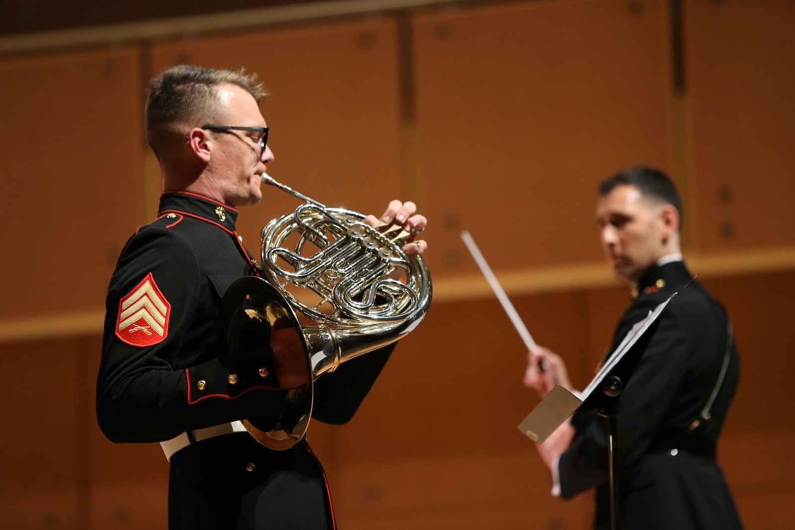 Sergeant John Brilhart, a musician with Marine Band San Diego, performs a solo at the Illinois State University Center for the Performing Arts during a tour of the Midwest. The band performs at more than 350 appearances per year. The band performs every Friday at Marine Corps Recruit Depot San Diego, California when they are not on tour. (Official U.S. Marine Corps photo by Sgt Calvin Hilt)