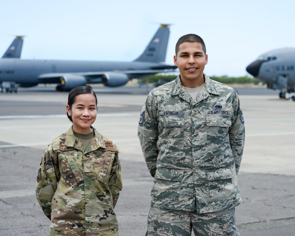 Staff Sgt. Carlyn Ramos, an integrated instument and flight control systems craftsman (left) and Staff Sgt. Nicholas Espinoza, an aircraft electrical and environmental systems technician (right), both assigned to the 735th Air Mobility Squadron, pose in front of KC-135 Stratotankers on the flight line at Joint Base Pearl Harbor-Hickam, Hawaii April 16, 2019. The 735th Air Mobility Squadron ensures incoming aircraft can complete their missions in the Pacific region. (U.S. Air National Guard photo by Staff Sgt. Steven Tucker)