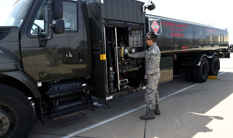 Airman 1st Class Kevin Molina, 627th Logistics Readiness Squadron fuels technician, adjusts the control panel on a fuel truck on March Air Reserve Base in California, March 1, 2019.
