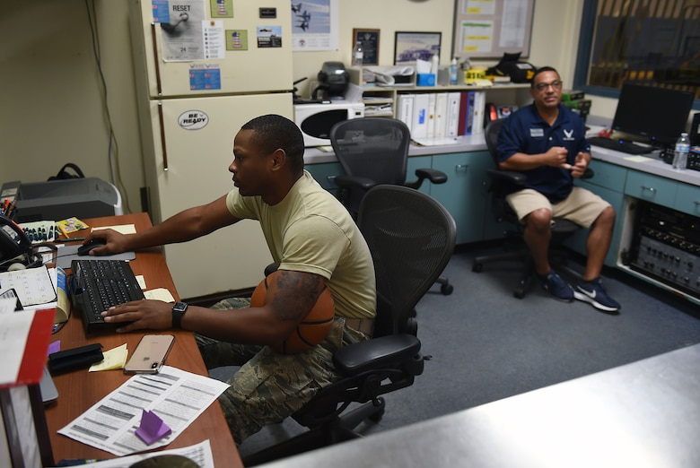 Airman 1st Class Shon Darra Smith, 627th Force Support Squadron fitness specialist, and Marco DeFelice, March Air Reserve Base fitness specialist, man the front desk at the March Air Reserve Base Fitness Center in California, March 1, 2019.