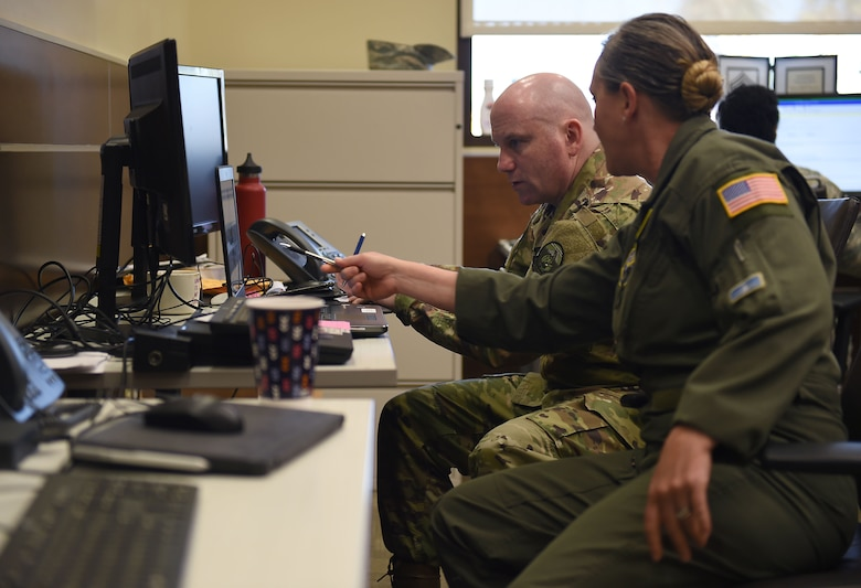 Chief Master Sgt. Stephanie Northup, 7th Airlift Squadron chief enlisted manager, far right, in-briefs Chief Master Sgt. Will Palmer, her replacement as the chief enlisted manager for McChord operations at March Air Reserve Base in California, March 2, 2019.