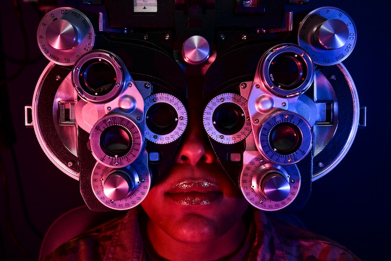 A patient looks through a phoropter during an eye examination training session at the Pittsburgh International Airport Air Reserve Station, Pennsylvania, April 11, 2019. The training session taught optometry personnel how to properly use a phoropter to determine the prescription of glasses a patient needs in order to correct their vision. (U.S. Air Force photo by Joshua J. Seybert)