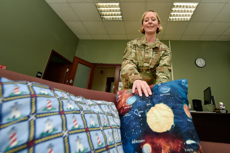 Staff Sgt. Melissa Vesco, 379th Expeditionary Logistics Readiness Squadron fuels distribution supervisor, arranges pillows on a chair at the Transient Oasis at Al Udeid Air Base, Qatar, April 18, 2019. The Transient Oasis opened April 11, 2019, as a focal point for in-transit service members and civilians waiting for travel home, or onward to deployed locations across U.S. Central Command. The 379th ELRS fuels distribution flight operates the facility 24/7 to ensure those in-transit have access to services including internet, information and amenities they may need. (U.S. Air Force photo by Tech. Sgt. Christopher Hubenthal)