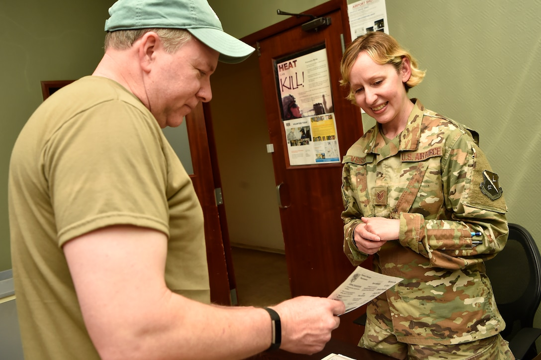 Staff Sgt. Melissa Vesco, right, 379th Expeditionary Logistics Readiness Squadron fuels distribution supervisor, provides travel information to Timothy Brecheen, left, in-transit civilian, at the Transient Oasis at Al Udeid Air Base, Qatar, April 18, 2019. The Transient Oasis opened April 11, 2019, as a focal point for in-transit service members and civilians waiting for travel home, or onward to deployed locations across U.S. Central Command. The 379th ELRS fuels distribution flight operates the facility 24/7 to ensure those in transit have access to services including internet, information and amenities they may need. (U.S. Air Force photo by Tech. Sgt. Christopher Hubenthal)