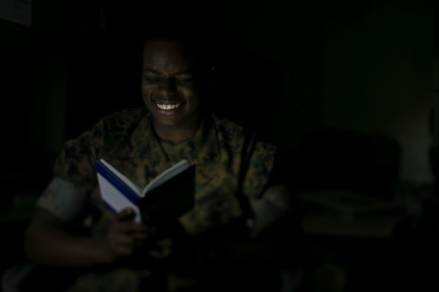 Lance Cpl. Tayvion Smith, a legal clerk with the 31st Marine Expeditionary Unit, reads a book at Camp Hansen, Okinawa, Japan, April 11, 2019.