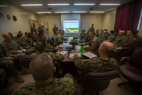 Col. Robert Brodie, commanding officer of the 31st Marine Expeditionary Unit, and Sgt. Maj. Edwin Mota, 31st MEU sergeant major, listen in on a confirmation brief during MEU Exercise at Camp Hansen, Okinawa, Japan, Dec. 12, 2018.