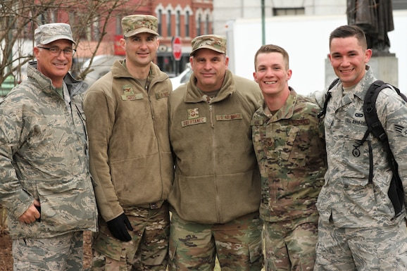 Tech Sgt. Kraig Hoag (fourth from left), a flight sergeant assigned to 157th ARW, poses with fellow airmen after completing a 12-mile ruck march that concluded the NHNG's Best Warrior Competition in Concord, N.H. on April 12.   Hoag was one of 26 competitors during the four-day competition, which also tested land navigation and marksmanship skills, and involved N.H. Army Guardsmen, a Coast Guardsman, and Salvadoran and Canadian armed forces. Also pictured, Chief Master Sgt. Robert Wheaton, Col. Todd Swass, Chief Master Sgt. David Obertanec, and Senior Airman Devon Dean, who was Hoag's coach and sponsor for the event.