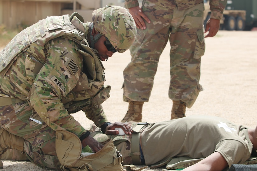 Spc. Shadarius Robinson treats a mock casualty during a Combat Lifesaver course conducted by the 300th Sustainment Brigade at Camp Arifjan, Kuwait, April 19, 2019.
