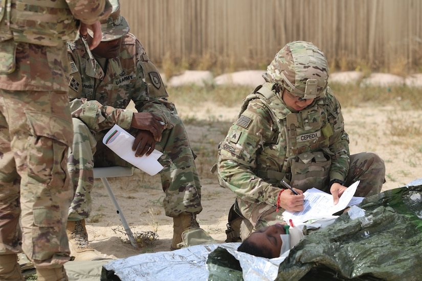 Sgt. Hilda Cepeda, 184th Sustainment Command, fills out a medical card during a Combat Life Saver course held by the 300th Sustainment Brigade at Camp Arifjan, Kuwait, April 19, 2019.