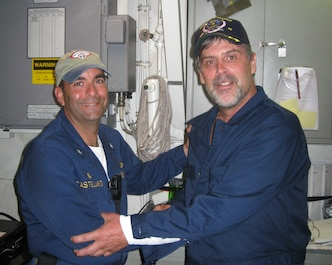 SOMALI BASIN (April 12, 2009)  Maersk-Alabama Capt. Richard Phillips, right, stands alongside Cmdr. Frank Castellano, commanding officer of USS Bainbridge (DDG 96) after being rescued by U.S Naval Forces off the coast of Somalia.  Philips was held hostage for four days by pirates. (Official U.S. Navy photo/RELEASED)