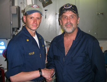 SOMALI BASIN (April 12, 2009)  Maersk-Alabama Capt. Richard Phillips, stands alongside Lt. Cmdr. David Fowler, executive officer of USS Bainbridge (DDG 96) after being rescued by U.S Naval Forces off the coast of Somalia.  Philips was held hostage for four days by pirates. (Official U.S. Navy photo/RELEASED)