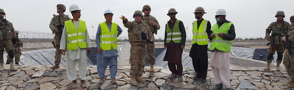 Mr. James Fielden pointing out the layout of the facility in front of the Settling Pond #2 to the Romanian Guardian Angels and MSG Galmines (USACE Guardian Angel) and TAAC-Air (Customer)