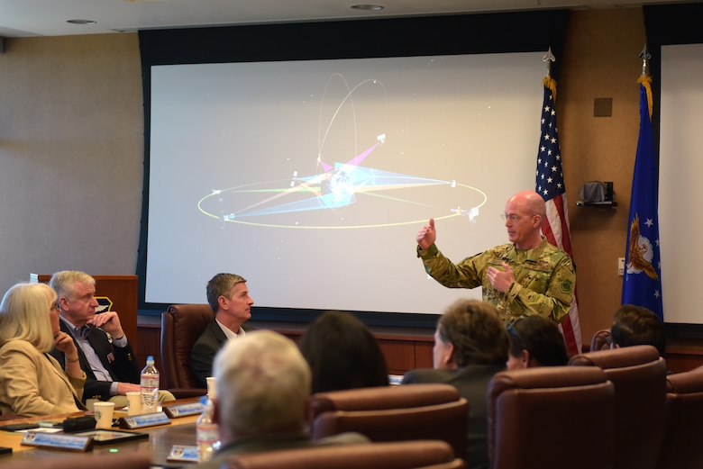 Col. Troy Endicott, 460th Space Wing commander, briefs about satellites to several Metro-Denver mayors at Buckley Air Force Base, Colorado, April 19, 2019.