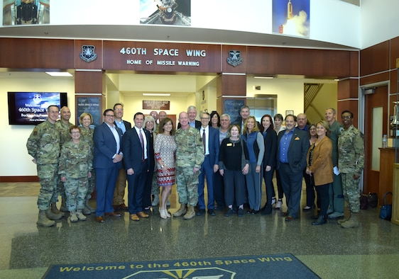 Several Metro-Denver mayors and Rep. Jason Crow pose in the 460th Space Wing Headquarter Building with Buckley Air Force Base leadership at Buckley Air Force Base, Colorado, April 19, 2019.