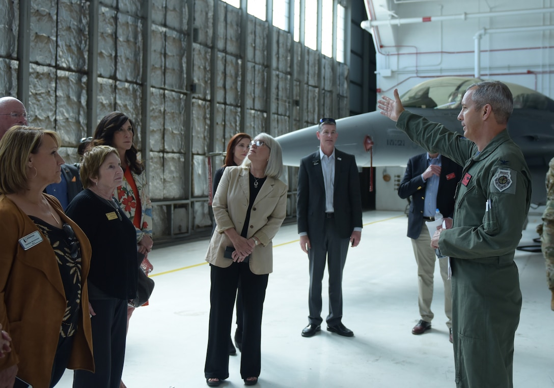 Col. Mitchel Neff, 140th Maintenance Group commander, briefs several Metro-Denver mayors about the F-16 Fighting Flacon at Buckley Air Force Base, Colorado, April 19, 2019.