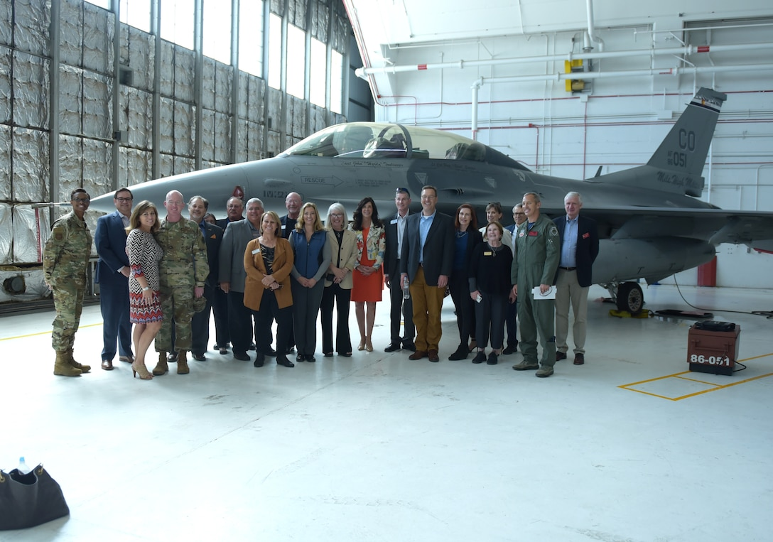 Several Metro-Denver mayors pose in front of an F-16 Fighting Falcon with 460th Space Wing leadership and 140th Wing leadership at Buckley Air Force Base, Colorado, April 19, 2019.