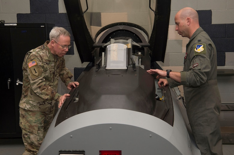Lt. Col. Eric Janski, 54th Operations Support Squadron director of staff, shows U.S. Army Brig. Gen. Gregory Brady, White Sands Missile Range installation commander, a model of an F-16 Fighting Falcon cockpit, April 18, 2019, on Holloman Air Force Base, N.M. Brady visited Holloman to gain a better understanding of the base's overall mission. (U.S. Air Force photo by Airman 1st Class Quion Lowe)