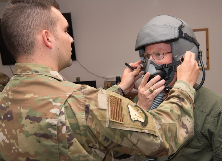 U.S. Army Brig. Gen. Gregory Brady, White Sands Missile Range installation commander gets assistance with putting his helmet on from Staff Sgt. Daniel Locke, 54th Operations Support Squadron Aircrew Flight Equipment technician, April 18, 2019, on Holloman Air Force Base, N.M. Brady visited Holloman to gain a better understanding of the base's overall mission. (U.S. Air Force photo by Airman 1st Class Quion Lowe)