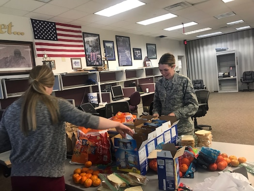 Tech. Sgt. Adrian Villa (right) and Senior Airman Hayley Sewell, reservists in the 419th Medical Squadron, pack sack lunches to be delivered April 19 to homeless children in the Salt Lake City area