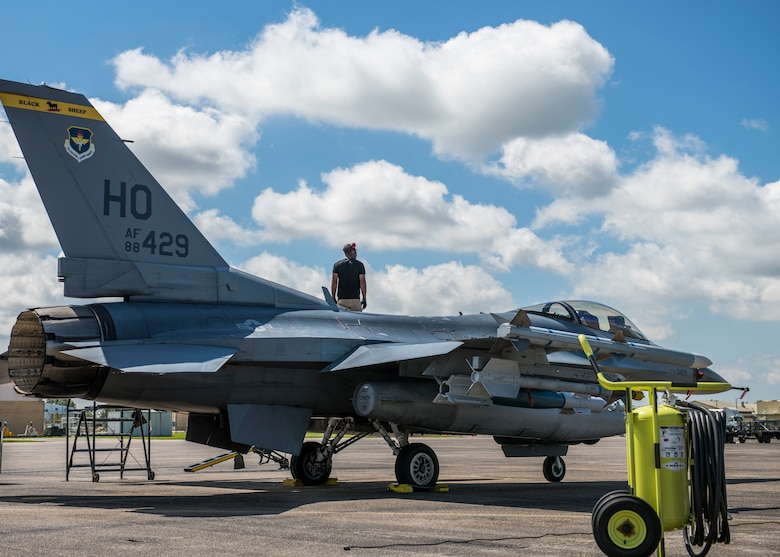 An 8th Fighter Squadron maintainer stands on an F-16 Fighting Falcon, April 9, 2019, on Naval Air Station Joint Reserve Base New Orleans, La. Of the 158 personnel that came on the temporary duty assignment, 106 were F-16 maintainers. (U.S. Air Force photo by Airman 1st Class Kindra Stewart)