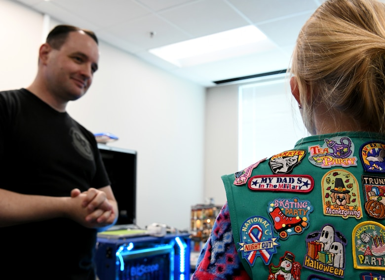 "Cody Jackson, 90th Cyberspace Operations Squadron constructive modeler, hosts a ""Bricks in the Loop"" tour for local Girl Scouts in San Antonio, Texas, April 19, 2019. ""Bricks in the Loop"" mimics an Air Force installation with items such as a fire station, police station, airport, jets and tanker trucks, all used to simulate real-world cyber systems in training cyber operators. (U.S. Air Force photo by Tech. Sgt. R.J. Biermann)"