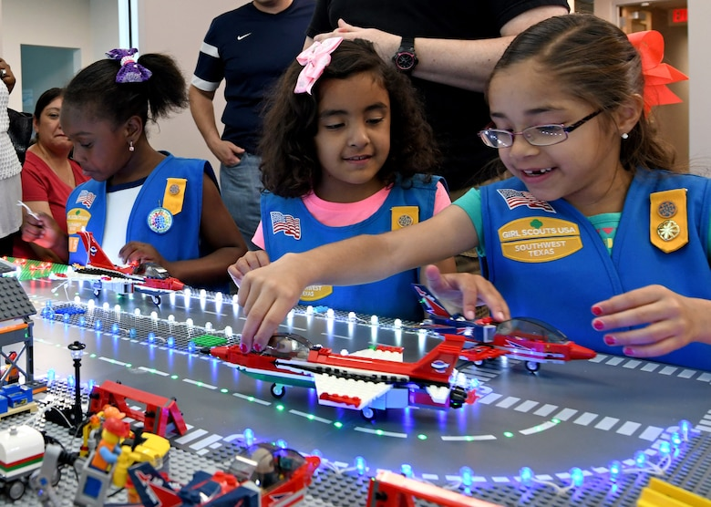 "San Antonio-area Girl Scouts visit the 90th Cyberspace Operations Squadron ""Bricks in the Loop"" for a tour April 19, 2019. ""Bricks in the Loop"" mimics an Air Force installation with items such as a fire station, police station, airport, jets and tanker trucks, all used to simulate real-world cyber systems in training cyber operators. (U.S. Air Force photo by Tech. Sgt. R.J. Biermann)"