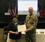 Rita McCarty has served as the Mississippi Army National Guard Cultural Resource Manager for 13 years. She was recognized by MSARNG Chief of Staff Col. Amos Parker with the Mississippi Meritorious Civilian Service Ribbon, the highest honor awarded to a civilian employee of the MSARNG. The Defense Department cited her program for an award.