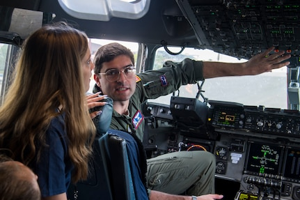 1st Lt. Derrin Gelston, 15th Airlift Squadron pilot, gives a cockpit tour to Take Flight Aviation Camp participants April 18, 2019 at Joint Base Charleston, S.C.