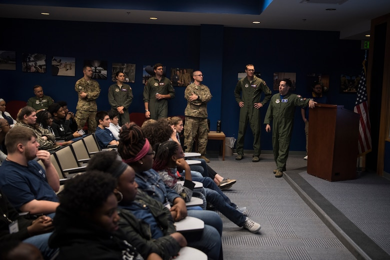 Retired U.S. Air Force Maj. Joshua Pugliese, former C-17 pilot, gives Take Flight Aviation Camp participants a briefing on his career and experiences before their tour started April 18, 2019, at Joint Base Charleston, S.C.