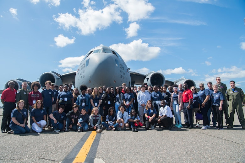 Participants from the Take Flight Aviation Camp pose in front of a C-17 Globemaster III April 18, 2019, at Joint Base Charleston, S.C.