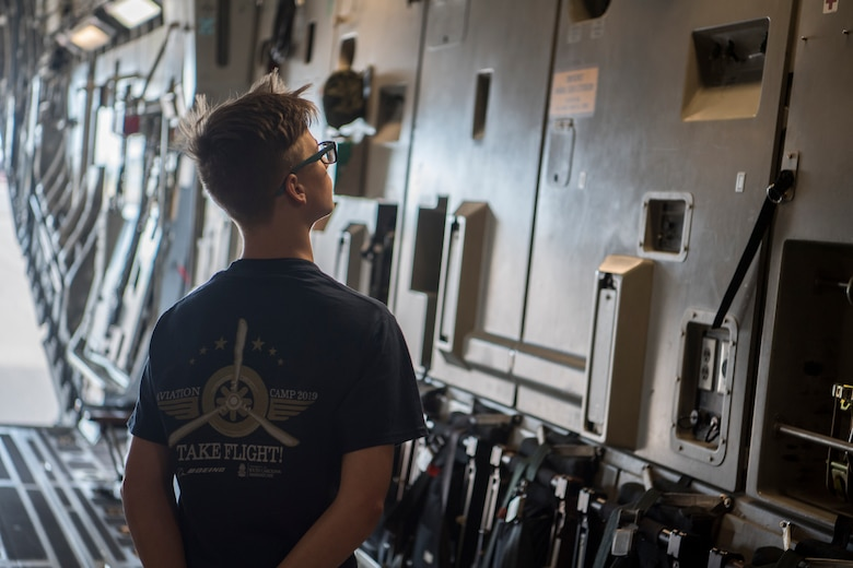 A participant in the Take Flight Aviation Camp tours a C-17 Globemaster III April 18, 2019, at Joint Base Charleston, S.C.