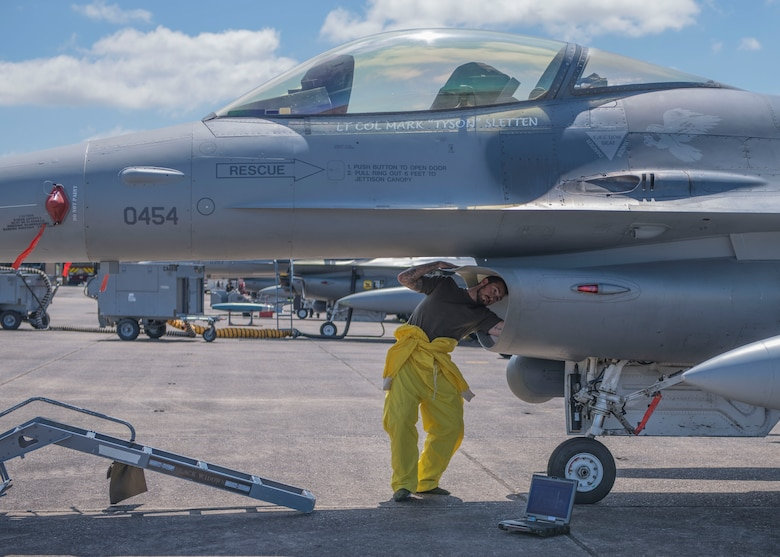 An 8th Fighter Squadron maintainer cleans the intake of an F-16 Fighting Falcon, April 9, 2019, on Naval Air Station Joint Reserve Base New Orleans, La. Lt. Col. Mark Sletten, 8th FS commander, said it was important to him to bring the entire squadron on the temporary duty assignment and train just as if they were going to fight. (U.S. Air Force photo by Airman 1st Class Kindra Stewart)