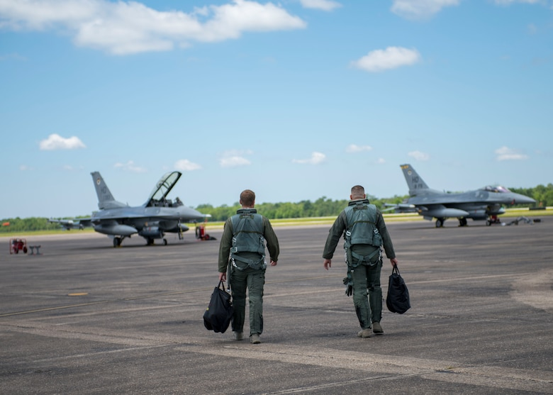 8th Fighter Squadron F-16 Fighting Falcon pilots step to their jets before a flight, April 9, 2019, on Naval Air Station Joint Reserve Base New Orleans, La. Holloman's 8th FS deployed on a temporary on a temporary duty assignment to Louisiana, and participated in training exercises, March 29, 2019 to April 12, 2019. (U.S. Air Force photo by Airman 1st Class Kindra Stewart)