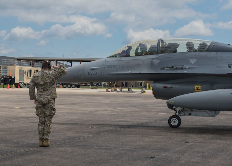 U.S. Air Force Master Sgt. Ryan Gentry salutes an F-16 pilot before a familiarization flight, April 9, 2019, Naval Air Station Joint Reserve Base New Orleans, La., and participated in a training exercise, March 29 to April 12, 2019. Many personnel were given the opportunity to go on a FAM flight in the back of an F-16 D-model during the temporary duty assignment. (U.S. Air Force photo by Airman 1st Class Kindra Stewart)
