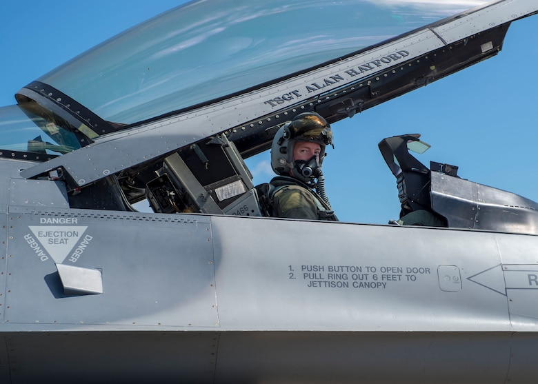 U.S. Air Force Capt. Nicholas Atkins, 8th Fighter Squadron F-16 Basic-Course student pilot, poses for a photo after a flight, April 9, 2019, on Naval Air Station Joint Reserve Base New Orleans, La. Flying over open water was one of the experiences the students had the opportunity to do while they were on  the temporary duty assignment to NAS JRB New Orleans. (U.S. Air Force photo by Airman 1st Class Kindra Stewart)