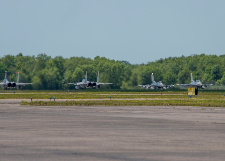 U.S. Air Force F-16 Fighting Falcons from Holloman's 8th Fighter Squadron, and F-15 Eagles from the Louisiana Guard National Guard's 159th Fighter Wing, taxi down the runway, April 10, 2019, on Naval Air Station Joint Reserve Base New Orleans, La. Pilots from the 8th FS participated in dissimilar aircraft training and close air support exercises with the Eagles from the 159th FW and joint terminal air controllers from the U.S. Army's 7th Special Forces Group. (U.S. Air Force photo by Airman 1st Class Kindra Stewart)