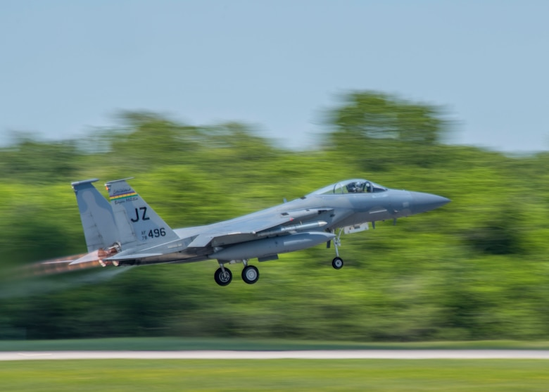 An F-15 Eagle from the Louisiana National Guard's 159th Fighter Wing takes off down the runway, April 10, 2019, on Naval Air Station Joint Reserve Base New Orleans, La. Lt. Col. Mark Sletten, 8th FS commander, said the unit set up simulated combat scenarios so the student pilots could practice working as a team with another unit. (U.S. Air Force photo by Airman 1st Class Kindra Stewart)
