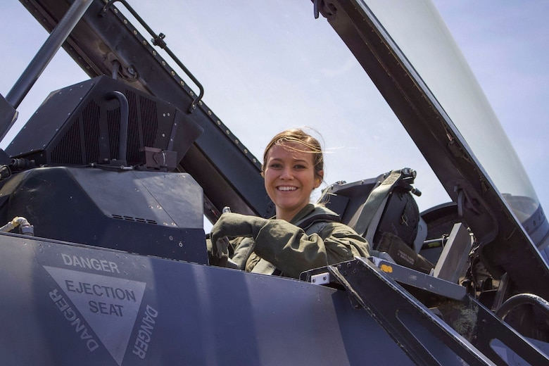 U.S. Air Force Airman Samantha Anderson, 54th Operations Support Squadron Aircrew Flight Equipment apprentice, poses for a photo before a familiarization flight in an F-16 Fighting Falcon during a temporary duty assignment with the 8th Fighter Squadron, March 29, 2019 to April 12, 2019, at Naval Air Station Joint Reserve Base New Orleans, La. Anderson said she experienced the gravitational pull of six times her body weight during her FAM flight. (Courtesy photo)