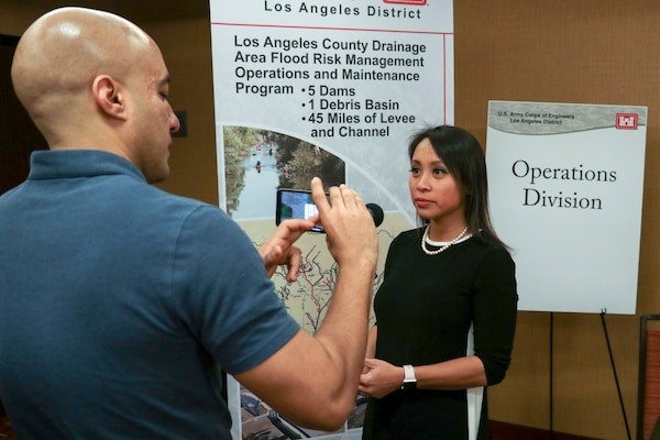 Lillian Doherty, Operations Division chief, speaks with Luciano Vera, public affairs specialist, at the Los Angeles District Arizona-Nevada Area Office's Business Opportunities Open House March 14 in Scottsdale, Arizona. Doherty emphasized the importance of the BOOH's relationship building to help identify what contractors have the capabilities to do the work ... that the Corps needs to get done.