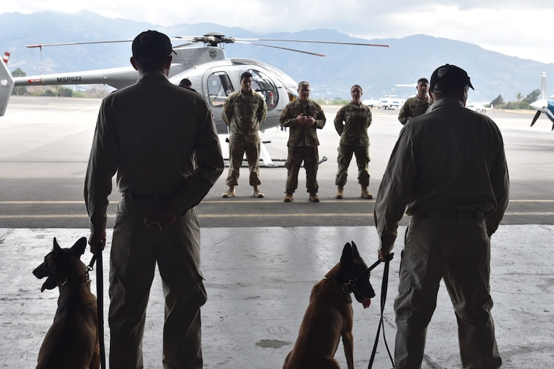 Master Sgt. Brandon VanWalraven, 571st Mobility Support Advisory Squadron mobile training team sergeant, speaks with the Costa Rican Air Vigilance Service dog handlers, April 1, 2019.  The team of six dog-handlers trained from March 26 through April 6 on new dog handling techniques to improved their day-to-day operations at the Juan Santamaria International Airport and other remote posts across Costa Rica. (U.S. Air Force photo by Maj. Noelle DeRuyter)