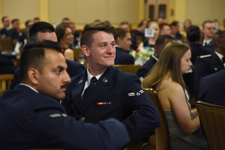 U.S. Air Force Airman 1st Class Matt Malcom, 338th Training Squadron student, attends the Airmen In Training Ball at the Bay Breeze Event Center on Keesler Air Force Base, Mississippi, April 19, 2019. The event, hosted by the 81st Training Group, is the first of its kind and was geared toward training Airmen on how to participate and act during a formal military ball so they can feel confident in their abilities when arriving at their follow-on locations. The Airmen served in key positions throughout the ball such as emcees, color guard, POW/MIA table ceremony, national anthem singer and the invocation. (U.S. Air Force photo by Kemberly Groue)