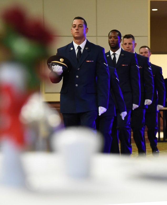 Airmen in the 81st Training Group participate in the POW/MIA table ceremony during the Airmen In Training Ball at the Bay Breeze Event Center on Keesler Air Force Base, Mississippi, April 19, 2019. The event, hosted by the 81st TRG, is the first of its kind and was geared toward training Airmen on how to participate and act during a formal military ball so they can feel confident in their abilities when arriving at their follow-on locations. The Airmen served in key positions throughout the ball such as emcees, color guard, POW/MIA table ceremony, national anthem singer and the invocation. (U.S. Air Force photo by Kemberly Groue)