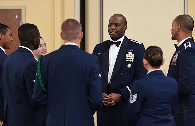 U.S. Air Force Col. Leo Lawson, Jr., 81st Training Group commander, speaks with Airmen during the Airmen In Training Ball at the Bay Breeze Event Center on Keesler Air Force Base, Mississippi, April 19, 2019. The event, hosted by the 81st TRG, is the first of its kind and was  geared toward training Airmen on how to participate and act during a formal military ball so they can feel confident in their abilities when arriving at their follow-on locations. The Airmen served in key positions throughout the ball such as emcees, color guard, POW/MIA table ceremony, national anthem singer and the invocation. (U.S. Air Force photo by Kemberly Groue)