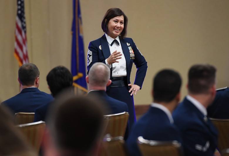 U.S. Air Force Chief Master Sgt. JoAnne Bass, 2nd Air Force command chief, delivers remarks during the Airmen In Training Ball at the Bay Breeze Event Center on Keesler Air Force Base, Mississippi, April 19, 2019. The event, hosted by the 81st Training Group, is the first of its kind and was geared toward training Airmen on how to participate and act during a formal military ball so they can feel confident in their abilities when arriving at their follow-on locations. The Airmen served in key positions throughout the ball such as emcees, color guard, POW/MIA table ceremony, national anthem singer and the invocation. (U.S. Air Force photo by Kemberly Groue)