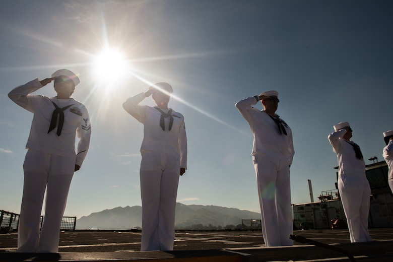 DILI, Timor-Leste (April 22, 2019) – Pacific Partnership 2019 personnel salute while manning the rails of the fast expeditionary transport ship USNS Fall River (T-EPF 4) during its arrival in Timor-Leste. Pacific Partnership, now in its 14th iteration, is the largest annual multinational humanitarian assistance and disaster relief preparedness mission conducted in the Indo-Pacific. Each year the mission team works collectively with host and partner nations to enhance regional interoperability and disaster response capabilities, increase security and stability in the region, and foster new and enduring friendships in the Indo-Pacific.