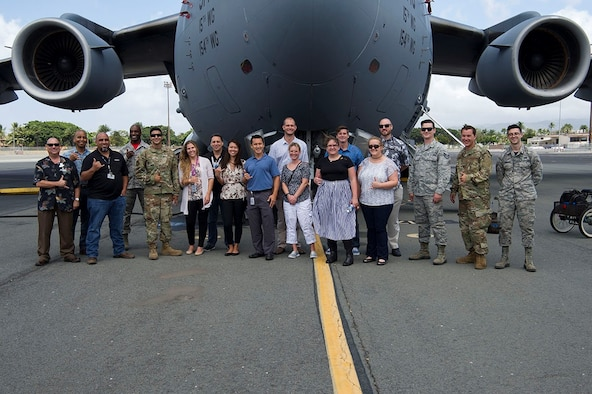 Airmen assigned to the 15th Aircraft Maintenance Squadron and Hawaiian Airlines maintainers pose for a photo in front of a C-17 Globemaster III on Joint Base Pearl Harbor-Hickam, Hawaii April 12, 2019. The 15th AMXS hosted Hawaiian Airlines as part of a continuous process improvement event to talk shop about maintenance, both military and civilian. (U.S. Air Force photo by 2nd Lt. Amber R. Kelly-Herard)