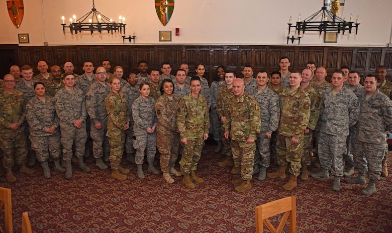 U.S. Air Force Chief Master Sgt. Anthony Cruz Munoz, Third Air Force command chief, poses for a photo with Airmen of the 100th Air Refueling Wing at RAF Mildenhall, England, April 3, 2019. Third AF leadership toured the 100th Logistics Readiness Squadron hangar, the 100th Communications Squadron control facility and the 100th Maintenance Squadron aircraft ground equipment shop. (U.S. Air Force photo by Airman 1st Class Brandon Esau)